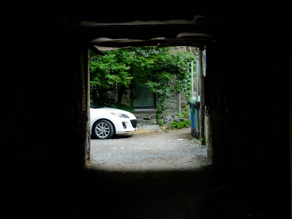 Car parked at the end of a tunnel